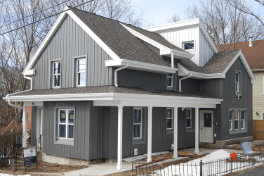 Gray Epping Street house with white trim completed