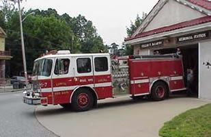 Engine 7 parked in front of a fire station