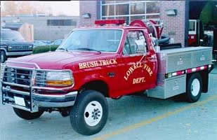 Brush 1 vehicle, a Ford F-350 parked in front of a fire station